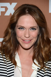 Katie Aselton stuck to simple loose waves and a center part while at the FX Upfront Bowing Event.
