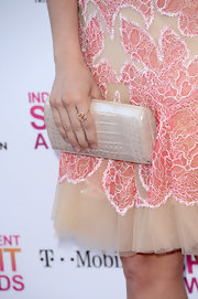 Brittany Snow opted for a simple and elegant look at the Independent Spirit Awards with a pearlized pink crocodile clutch.