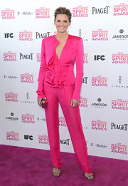 Stana Katic matched the pink carpet at the Independent Spirit Awards with this pink pantsuit with ruffled blazer.