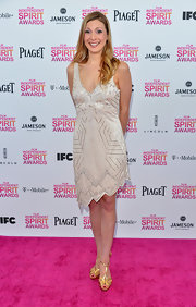 Lucy Alibar opted for an Art Deco-inspired asymmetrical cocktail dress for her Independent Spirit Award look.