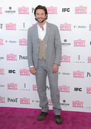 Bradley Cooper opted for  more casual look at the Independent Spirit Awards with this gray three-button suit.