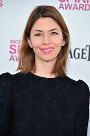 Sofia Coppola may have opted for a more minimal hair and makeup look, but the director added a pop of pink to her lips for some extra fun!