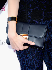 Sofia Coppola opted for a navy look from head to toe with this navy suede clutch.