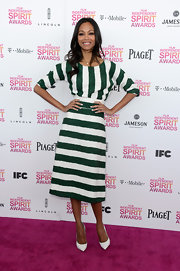Zoe Saldana looked fun and carefree on the pink carpet at the Independent Spirit Awards in a green and white striped frock.