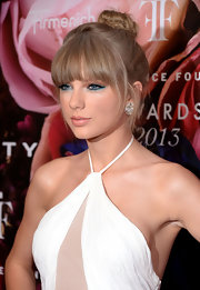 Taylor's dirty blonde tresses looked totally whimsical and chic when piled on top of her head in this top knot bun.