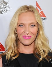Toni Collette brightened up the red carpet with this electric pink lip color.