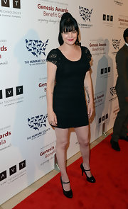 Pauley Perrette stayed true to her punk style with a monochromatic red carpet look.