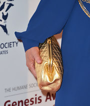 Shannon Tweed carried a quilted metallic clutch at the 2013 Genesis Awards Gala.