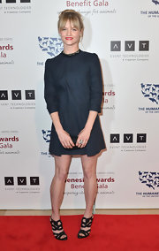 Lindsay Pulsipher showed off her chic, mod-style with this navy dress with embellished neckline.