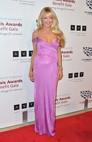 Charlotte Ross chose a lavender evening dress with criss-cross bodice designs for her red carpet look.