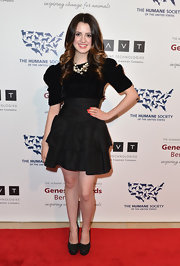 Laura Marano chose a classic LBD with velvet puffed sleeves and a tiered, ruffle skirt for her look at the 2013 Genesis Awards Gala.