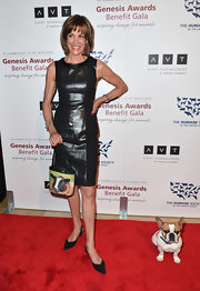 Wendy Malick chose a black leather dress to show off her curves at the 2013 Genesis Awards Gala.