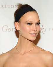 Karlie Kloss pulled her hair up in a neat top knot for the Gordon Parks Foundation Awards.