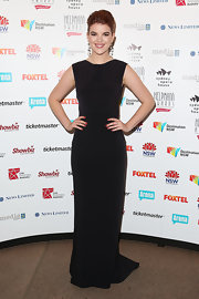 Emma stuck to a simple column-style black gown for the 2013 Helpmann Awards.