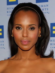 Kerry Washington kept her beauty look natural and minimal with this nude lip.