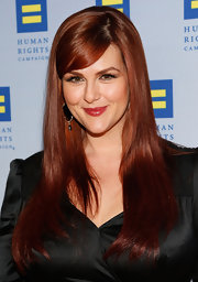 Sara Rue's deep strawberry locks looked extra-shiny and sleek when styled into this straight 'do with side-swept bangs.
