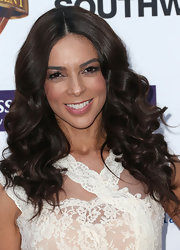 Terri Seymour showed off her long chocolate locks with a glamorous curly 'do.