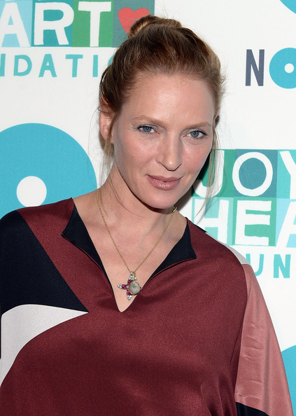 Uma Thurman chose a classic bun for her red carpet look while at the Joyful Heart Foundation Gala in NYC.