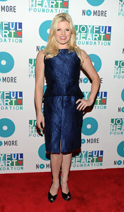Megan Hilty's deep navy satin peplum dress looked sleek and contemporary on the actress at the joyful Heart Foundation Gala.