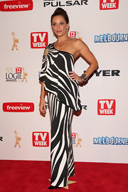 Georgie Parker chose a black-and-white striped dress, which featured a one-shoulder, embellished sleeve, for her red carpet look.
