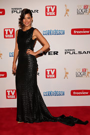 Rhiannon Fish went with the all-black look at the 2013 Logies when she opted for this shimmery black gown, featuring a flowing train.