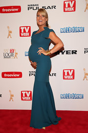 Natalie Bassingthwaighte proudly showed off her baby bump with this gorgeous blue gown.