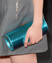 Krysten Ritter added shine and color to her ensemble at the premiere of 'The Way, Way Back' with a metallic blue tube clutch.