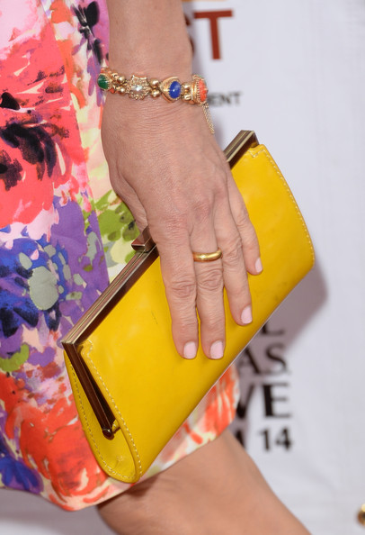 Allison Janney went all out with the brights with this yellow frame clutch and print dress combo at the premiere of 'The Way, Way Back.'