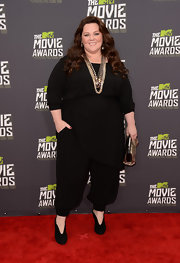 Melissa McCarthy looked chic in all-black when she sported this draped jumpsuit.