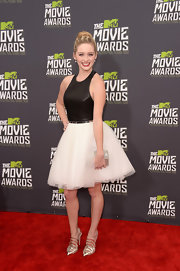 Greer Grammer chose a fun and flirty cocktail frock that had a fitted leather bodice and a full tulle skirt.