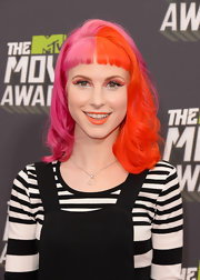 We think it's safe to say Hayley Williams is the queen of bright makeup, like these bright tangerine lips.