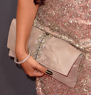 Snooki matched her bag to her dress with this oversized beige clutch that featured an embellished strip down the center.