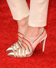 Bella Thorne looked mature and sophisticated from head-to-toe with this silver evening sling-back sandal.
