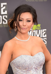 Jenni Farley rocked a slightly messy updo with free-flowing curls while at the 2013 MTV Movie Awards.