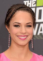 Alexis Knapp chose tight braids to show off her brunette locks at the 2013 MTV Movie Awards.
