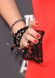 Jessica Lu piled on the beads at the MTV Movie Awards, where she sported these gray and black beaded bracelets.