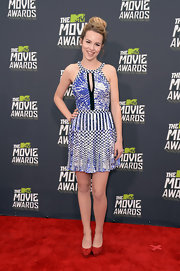 Bridgit Mendler looked fun and flirty in a vibrant printed dress that featured a keyhole cutout, a halter neck and a sleek pleated skirt.