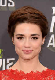 Crystal Reed piled her brown locks onto her head for a slightly messy, bobby-pinned 'do.