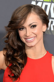 Karina Smirnoff chose a deep side part to show off her glamorous curls.