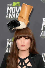 Hana Mae Lee definitely made a statement on the red carpet of the 2013 MTV Movie Awards when she sported this cigarette-butt hat.