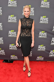 Desi Lydic's black lace blouse added just a touch of sex appeal to the star's look at the MTV Movie Awards.