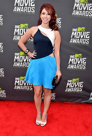 Jillian Rose Reed chose an abstract cutout dress for her cool and contemporary look at the 2013 MTV Movie Awards.