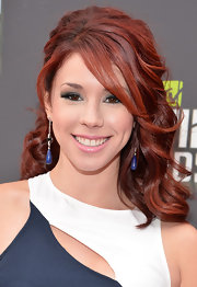 Jillian Rose Reed looked glamorous on the red carpet when she sported a half up, half down 'do.
