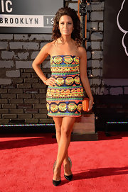 Rocsi opted for a bold and bright printed mini dress for her colorful red carpet look at the VMAs.