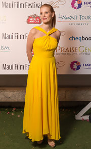 Jessica looked summery as ever while in Hawaii when she wore this sunshine yellow twisted-neck halter dress.
