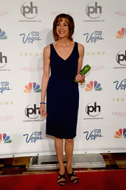 Wendie Malick sported a classic deep navy V-neck dress at the Miss USA Pageant.