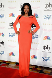 Nana chose a long-sleeve orange gown for her red carpet look at the Miss USA Pageant.