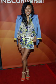 A pastel-blue blazer added a formal touch to Jeannie Mai's shorts and button-down combo at the NBC Universal Summer Press Day.