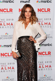 Jessica Alba's black and silver Edie Parker box clutch perfectly complemented her Juan Carlos Obando outfit at the ALMA Awards.