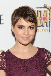 Sami Gayle kept it subtle with pale pink lipstick.